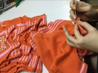 high end sweater production - hand crochet | Fine Knitting